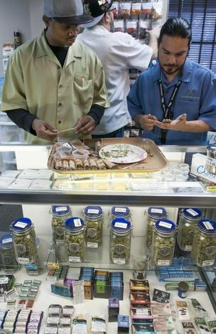 Budtenders at Medicine Man in Denver, Danny Curley and David Marlow. Medicine Man was mailed a license to sell retail marijuana from the State of Colorado.
